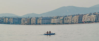 Canoeing in the city. A picture of people canoeing in the sea in a greek town thessaloniki,in a summer day Royalty Free Stock Image