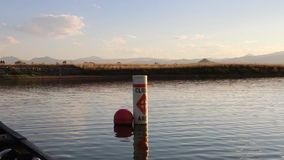 Canoeing By A Closed Area. Buoy on Lagerman Reservoir in Longmont, CO stock video footage