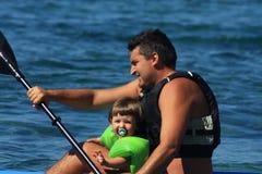 Canoeing da família Imagem de Stock Royalty Free