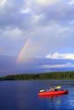 Canoeing della ragazza Immagini Stock