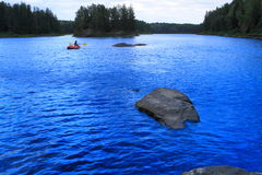 Canoeing della ragazza Fotografie Stock