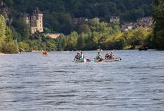 Canoeing on Dordogne river in La Roque-Gageac, Aquitaine, France. La Roque-Gageac, Dordogne, France - September 7, 2018: Canoeing on Dordogne river in La Roque stock photo