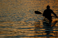 Canoeing at dusk Royalty Free Stock Photography