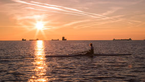 Canoeing in the evening in bay of Trieste Stock Image
