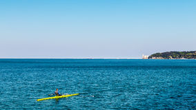 Canoeing in the evening in bay of Trieste Royalty Free Stock Photography