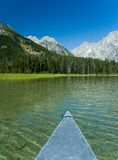Canoeing in the grand tetons royalty free stock photo