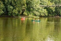 Canoeing on the James River. Botetourt County, VA – August 12th: Canoeing on the James River going under a hanging bridge located in Buchanan, Botetourt royalty free stock photo