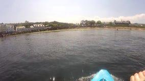 Canoeing Kayaking Cushendun Co Antrim Ireland. Canoeing Kayaking in Cushendun Co Antrim Ireland stock footage