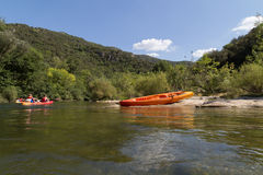 Canoeing and Kayaking on River, Forest Landscape and Blue Sky Royalty Free Stock Image