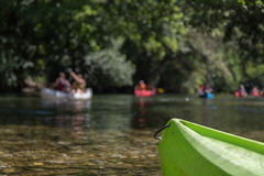Canoeing and Kayaking on River and Lake in Forest during Summer Stock Photography