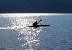 Canoeing on Lake. Silhouette of a man canoeing on Lake Royalty Free Stock Photos