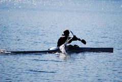 Canoeing on Lake. Silhouette of a man canoeing on Lake Royalty Free Stock Photography
