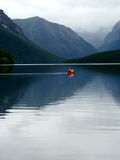 Canoeing on lake. Red canoe on lake at glacier national park Royalty Free Stock Images