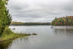 Canoeing on a Lake in Autumn - Algonquin Provincial Park, Ontari Stock Image