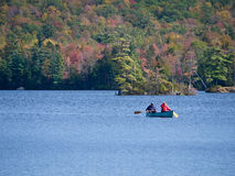Canoeing on lake in fall Stock Photos