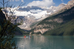 Canoeing on Lake Louise. In the Canadian Rocky Mountains stock photos