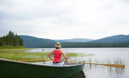 Canoeing on Lake Noel. Lake Noel in Reserve Faunique des Laurentides, Jacques-Cartier National Park, Quebec, Canada Royalty Free Stock Image