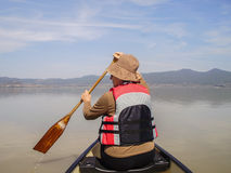 Canoeing on Lake Patzcuaro. Paddling a canoe on Lake Patzcuaro, Michoacan, Mexico Royalty Free Stock Photo