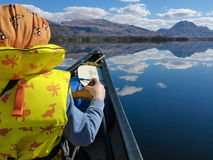 Canoeing on a loch Royalty Free Stock Image