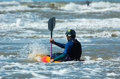 Canoeing in the ocean stock photo