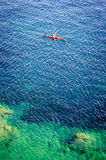 Canoeing in the ocean Royalty Free Stock Photo