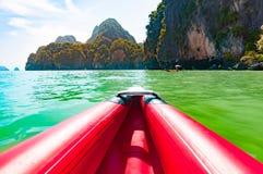 Canoeing in Phang nga bay along the large limestone rocks, Thail Stock Photos