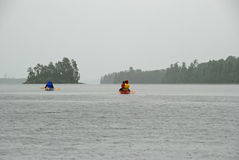 Canoeing into the rain Royalty Free Stock Image