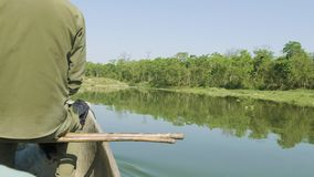 Canoeing in the river of rainforest in the national park Chitwan, Nepal. Canoeing in the river of rainforest in the national park Chitwan, Nepal stock video footage