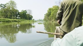 Canoeing in the river of rainforest in the national park Chitwan, Nepal. Canoeing in the river of rainforest in the national park Chitwan, Nepal stock footage