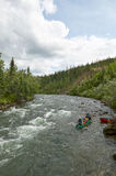 Canoeing on river rapids in wild, remote Alaska Stock Photos