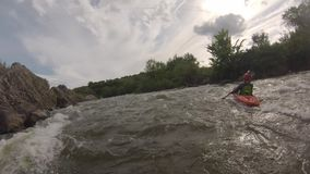 Canoeing on the rough mountain river stock video footage