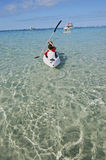 Canoeing in the shallow water. Showing the white sandy bottom and the beautiful hot summer day Stock Image