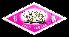 Canoeing (Summer Olympics 1964, Tokyo), serie, circa 1964. MOSCOW, RUSSIA - NOVEMBER 25, 2017: A stamp printed in Romania shows Canoeing (Summer Olympics 1964 Royalty Free Stock Photo