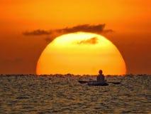 Canoeing on sunset royalty free stock photos