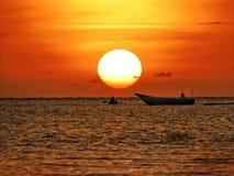 Canoeing on sunset stock photos