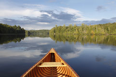 Canoeing on a Tranquil Lake. Bow of a Cedar Canoe on a Tranquil Lake - Ontario, Canada Royalty Free Stock Photography