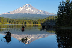 Canoeing at Trillium Lake in Oregon with water reflection royalty free stock photography