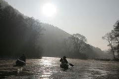 Canoeing in the wild. Winter canoeing in the wild royalty free stock photos
