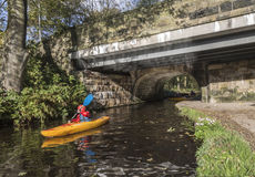 Canoeist with class at canal bridge at Uppermill Royalty Free Stock Photography