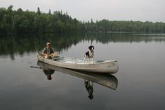 Canoeist and Dog Stock Photo