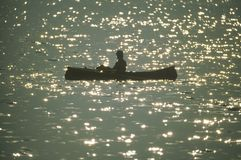 Canoeist on Lake Stock Photo