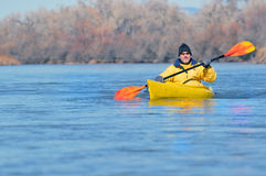 Canoeist on scenic river Royalty Free Stock Photo