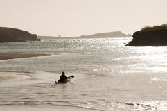 Canoeist in the Sea at Porth Beach Stock Photo