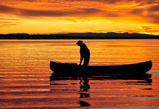 Canoeist at sunset. A canoeist on Moreton Bay at sunset Stock Photo