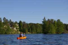 Canoeist sur le lac Photographie stock libre de droits