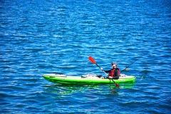 Canoeist in Valletta harbour, Malta. Royalty Free Stock Images