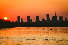Canoeist on Vistula river. Sunset over Warsaw city and canoeists on Vistula river Royalty Free Stock Photos