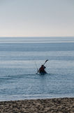 Canoeist wiht fishing rod, Mediterranean Sea, Spain Stock Photos