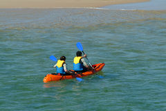 Canoeists. In beach Royalty Free Stock Photography