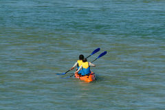 Canoeists. In beach Royalty Free Stock Photos